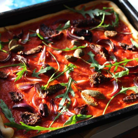 Capition of Rocket and Caperberry Pizza. Image by Edward Daniel (c).