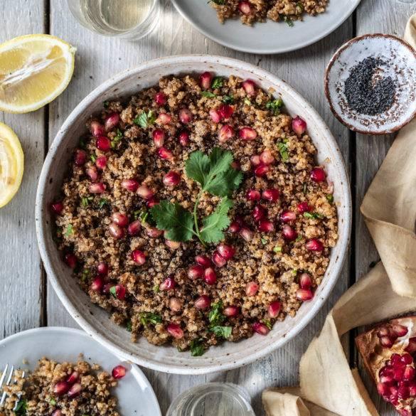Caption of Coriander Pomegranate Quinoa Salad Flatlay. Image by Edward Daniel (c).