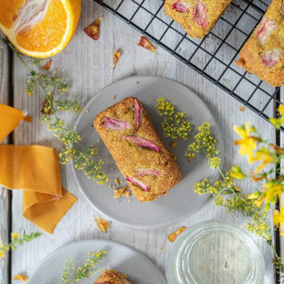Citrusy orange nicely balanced with tangy hints of rhubarb spatially littered across this moist gluten-free Rhubarb and Orange Cake.